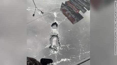 A photo released by the Ukrainian Interior Ministry press office shows the bullet impacts on vehicle.