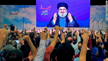Hezbollah leader Hassan Nasrallah is cheered by supporters during a speech in November 2019.