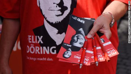 Pamphlets are given out by the Social Democrats (SPD) at the main square in Alsfeld.