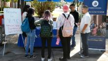 Students at Phoenix College gather to fill out voter registration forms on September 24, 2019, in Phoenix, Arizona.
