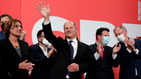 SPD's Olaf Scholz waves to his supporters after the German parliamentary elections at the party's headquarters in Berlin, on 26 September.