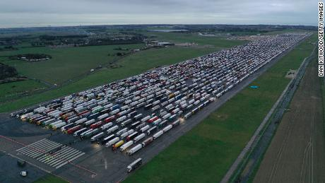 Trucks parked on the runway at Manston Airport in England waiting to cross the English Channel on December 22, 2020.