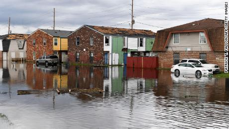 Homes stand partially flooded in LaPlace, Louisiana in the aftermath of Hurricane Ida.