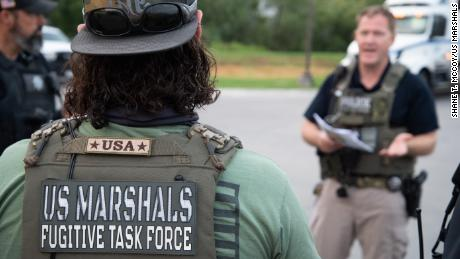 US Marshals Service Metro Fugitive Task Force (MFTF) agents during the operation.