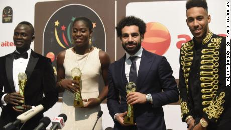 Soccer Royalty: The Nigerian picked her third African Women's Footballer of the Year award at the 2017 CAF Awards with Liverpool and Egypt's Mohamed Salah (R) taking the men's award.