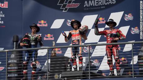 Fabio Quartaro, Marc Marquez and Bagania celebrate on the podium after the MotoGP Grand Prix of Racing America on October 03, 2021 in Austin, Texas.