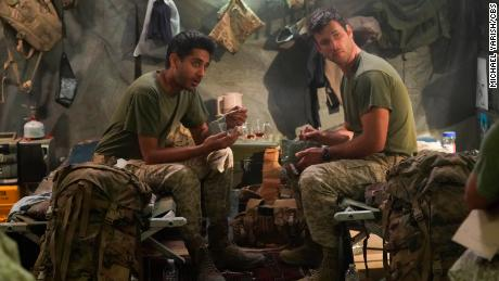 """'The United States of Al"""" is inspired by """"experiences of the Afghan and military veteran writers on the series who worked together to evacuate family members during the takeover of Afghanistan,"""" according to CBS. Adhir Kalyan and Parker Young, shown here, star in the series."""