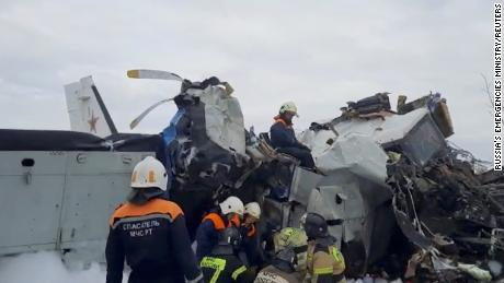 Emergency specialists work at the crash site of the L-410 plane near the town of Menzelinsk in the Republic of Tatarstan, Russia October 10.