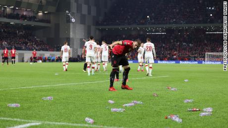 Objects are thrown onto the pitch during the World Cup qualifier between Albania and Poland.