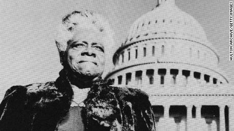 Mary McLeod Bethune circa 1950 standing with the US Capitol in the background.