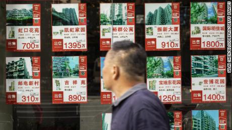Listings of apartments for sale displayed at a real estate office in Shanghai, China, on Monday, Aug. 30, 2021.