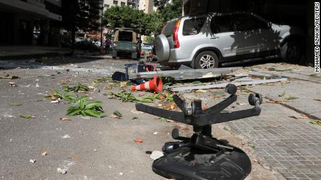 Shattered glass and debris are seen after gunfire erupted in Lebanon's capital on Thursday.