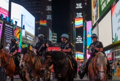NYPD's Mounted Unit patrol officers stand in front of the Pride and Black Lives Matter billboards in Times Square on June 22, 2020 in New York City. Due to the ongoing coronavirus pandemic, this year's Pride march had to be canceled over health concerns. The annual event, which sees millions of attendees, marks it's 50th anniversary since the first march following the Stonewall Inn riots. (Photo by Noam Galai/Getty Images)