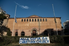 A banner in front of a Greek Orthodox Church in the Greek city of Thessaloniki on Friday. (Photo by Sakis Mitrolidis/AFP via Getty Images)