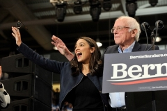 """Rep. Alexandria Ocasio-Cortez campaigned for Sen. Bernie Sanders, and then after he ended his presidential campaign co-chaired a Sanders-Biden """"unity taskforce"""" on climate. (Photo by Joseph Prezioso/AFP via Getty Images)"""