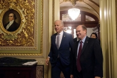 Vice President Joe Biden walks out of the Senate chamber with Sen. Chris Coons (D-Del.) after attending a bipartisan tribute honoring Biden's service as a member of the Senate and as vice president on December 7, 2016. (Photo by Nicholas Kamm/AFP via Getty Images)
