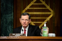 "Senator John Barrasso, a Republican from Wyoming and chairman of the Senate Environment and Public Works Committee, places a bottle of hand sanitizer on the dais during a hearing titled ""Oversight of the Environmental Protection Agency"" in the Dirksen Senate Office Building on May 20, 2020 in Washington, DC. (Photo by AL DRAGO/POOL/AFP via Getty Images)"