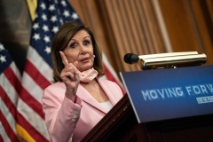 House Speaker Nancy Pelosi gives a speech. (Photo credit: NICHOLAS KAMM/AFP via Getty Images)