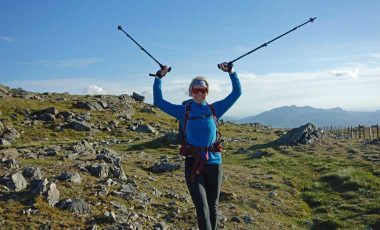 Woman hiking with poles