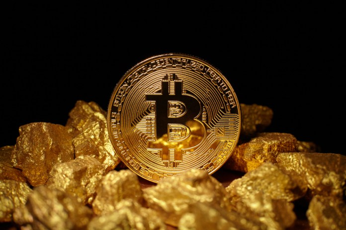 Bitcoin atop a mound of gold.