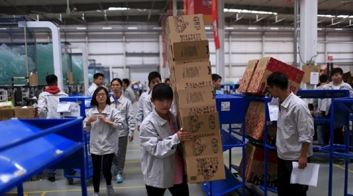 T-Mall workers at a logistics center in Suzhou, Jiangsu Province, China.