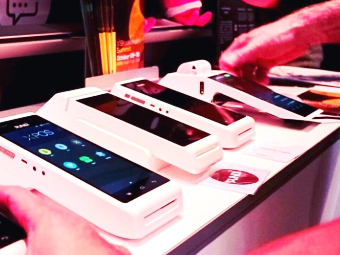 Pundi X POS devices on display. Pundi X provides a secure and versatile platform for both traditional as well as crytpcurrency payment methods secured by the blockchain.