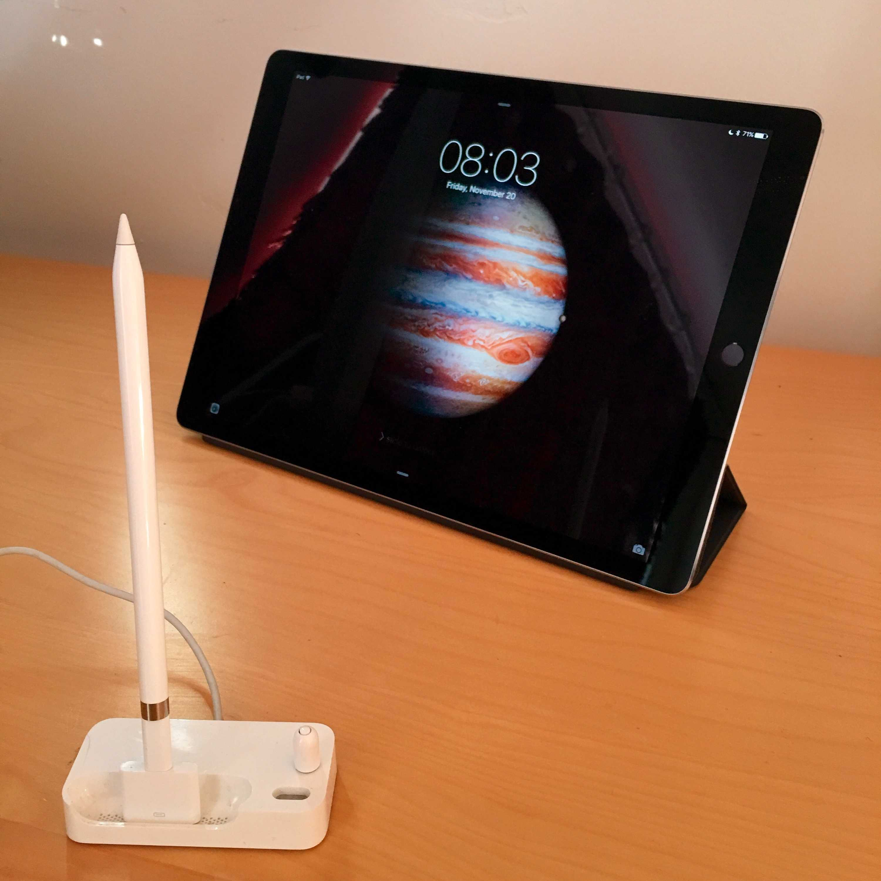 Using an old iPhone Bluetooth Headset dock as an Apple Pencil dock.