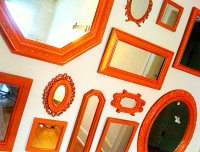 grouping of red vintage wall mirrors - Decoist