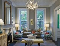 living room with grey sofa with turquoise accents and ...