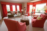 coral red and tan living room - Decoist