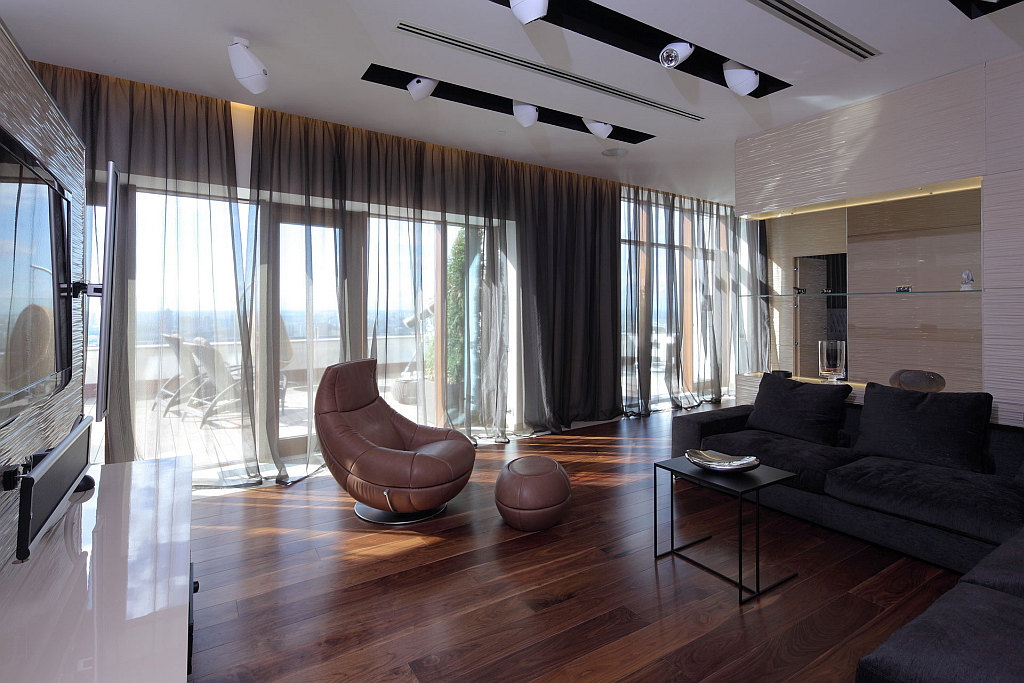 modern living room with dark wood floors high back wing chairs for choosing the best flooring your home view in gallery