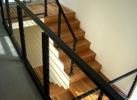 A modern metal handrail in two tones