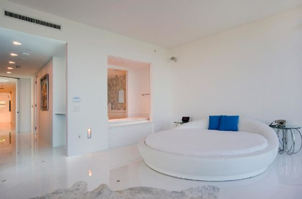 Pristine white room sports an equally classy circle bed