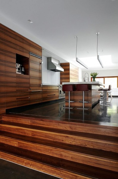 modern architecture kitchen Modern Semi- Minimalist Residence Wrapped In Natural Wood