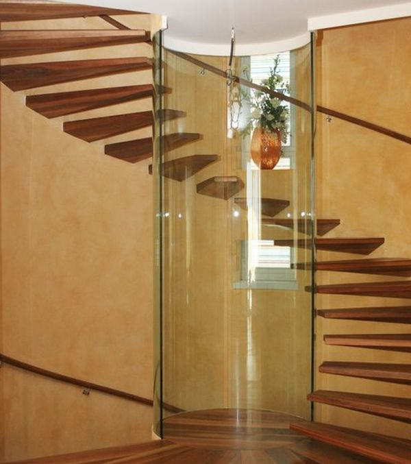 Astonishing spiral staircase with floating steps and a glass column at its heart
