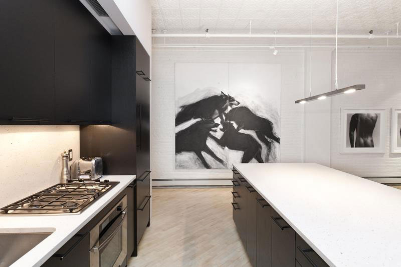 Stylish SoHo Loft In New York Features a Trendy Black and White Interior