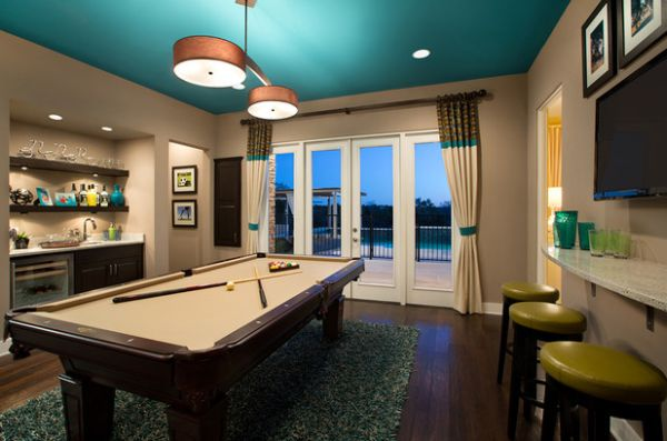Especially when you're playing said games on a table that transforms from the pool table you're playing on to the dining table you're about to eat on. Indulge Your Playful Spirit with These Game Room Ideas