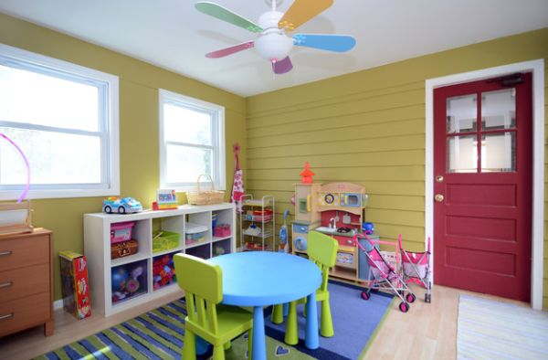 Charming little fan accentuates the color scheme of the playroom