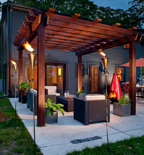 View In Gallery Snazzy Pergola Has A Medieval Charm Thanks To The Fiery Additions