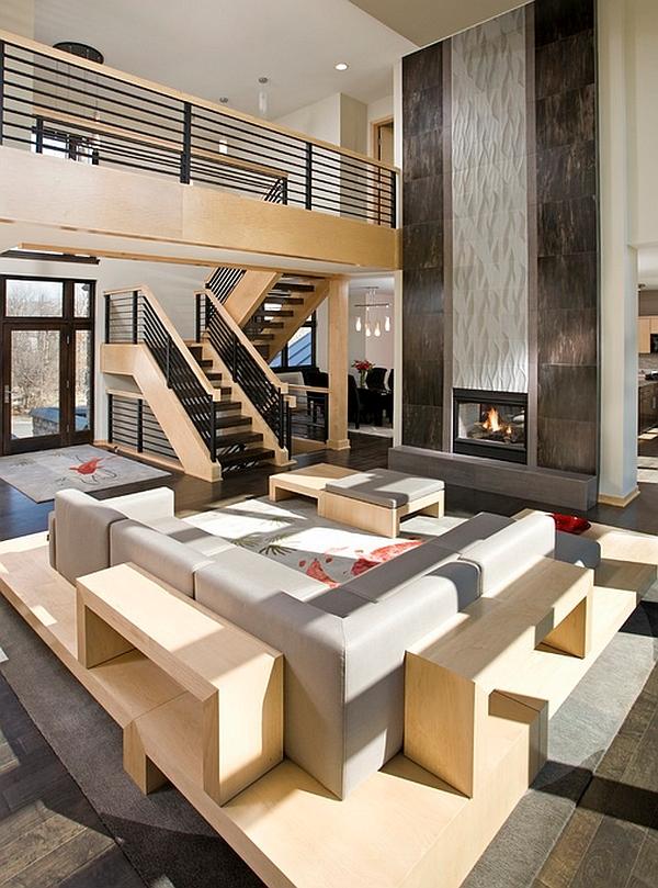 barandillas de acero chimenea negrita definen zona lujosa de estar piso abierto