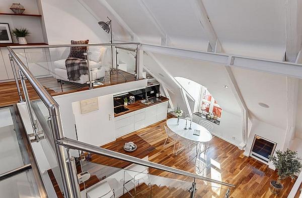 hogar moderno exqusite combina superficies blancas prístinas con tonos cálidos de madera