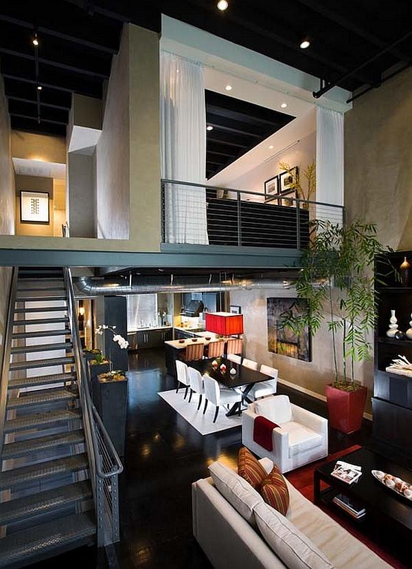 Loft industrial con un altillo que cuenta con un dormitorio de invitados