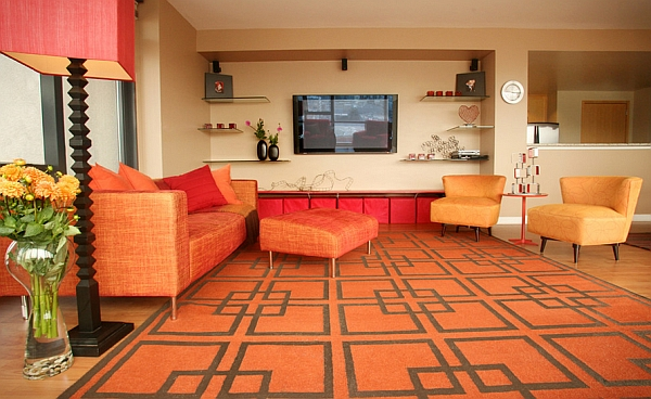 Bright orange and the geometric rug usher in the retro vibe