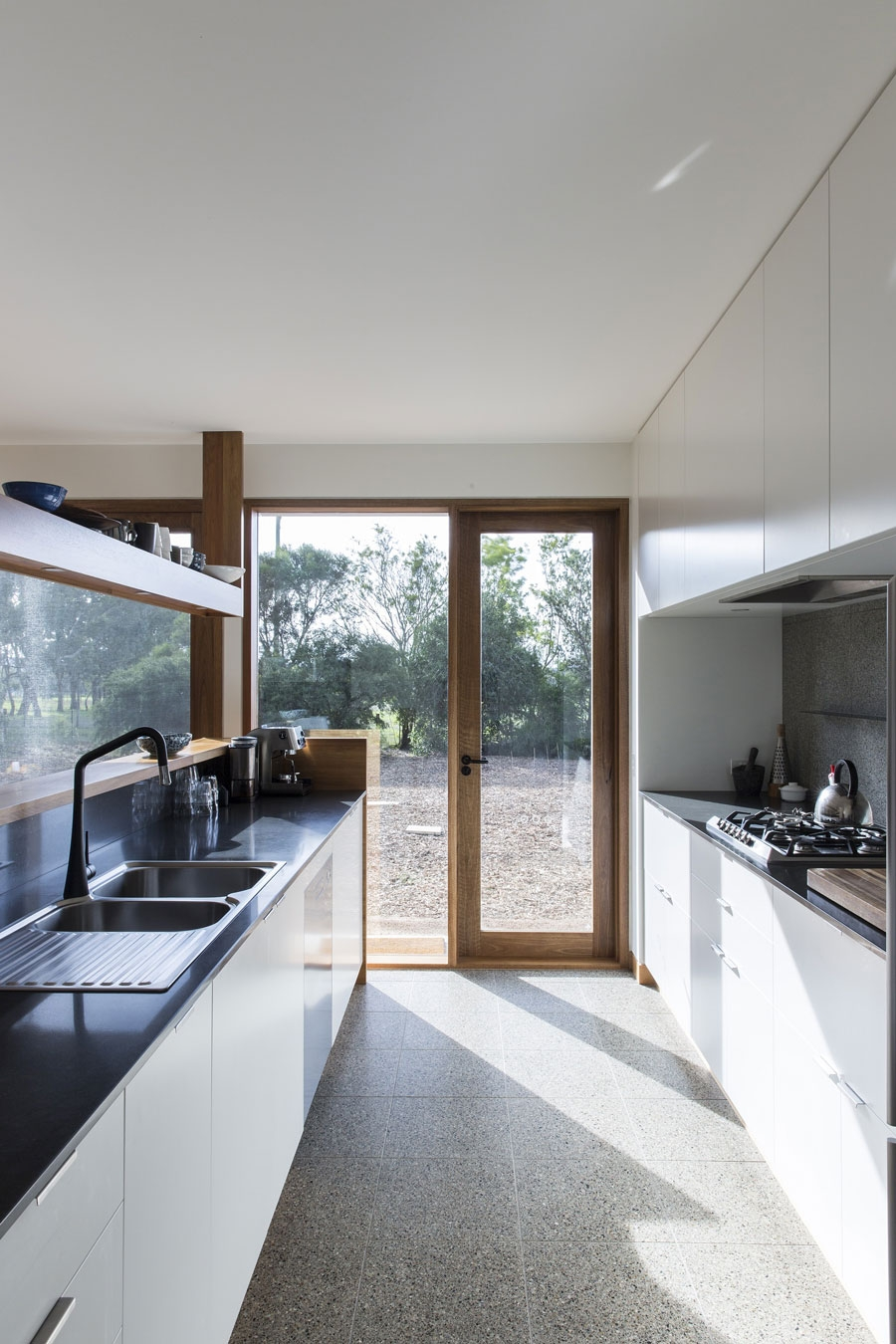 Energy Efficient Home Charms With A Distinct Roof And An