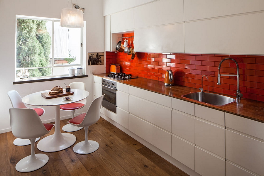 brick backsplash in kitchen mid level cabinets small apartment tel aviv gets a trendy modern makeover