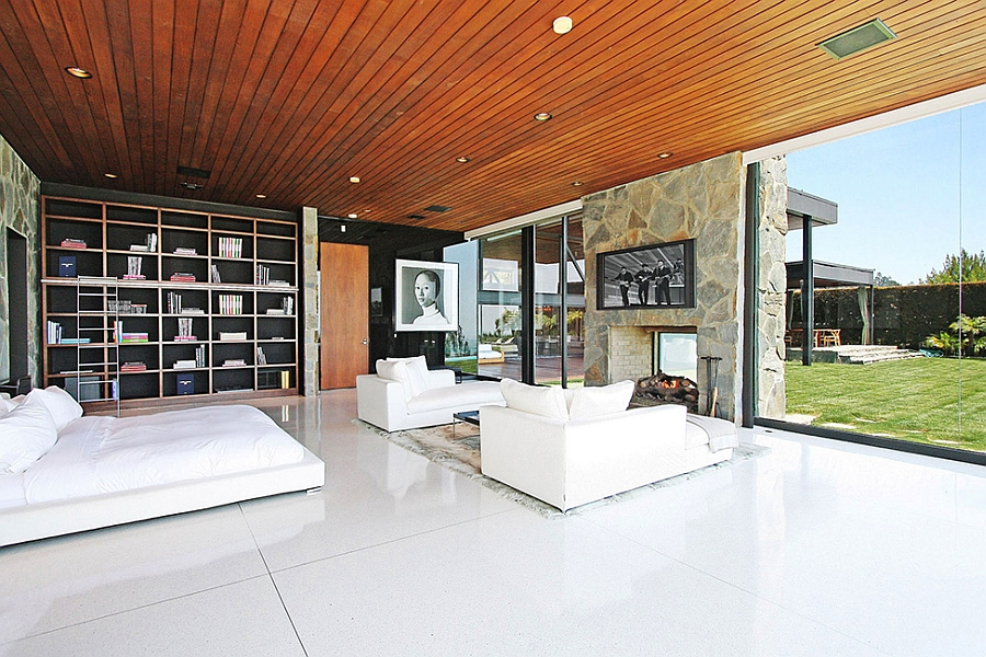 glass and wood dining table chairs kitchen arm luxurious beverly hills mansion acquires a sparkling new interior