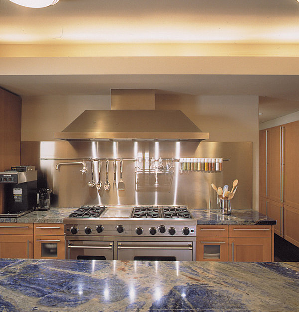 Stainless steel backdrop in a kitchen with blue countertops