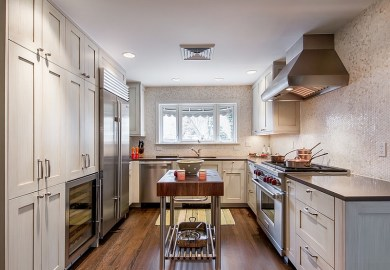 Kitchen Island Adds Visual Excitement To The Narrow Kitchen Layout