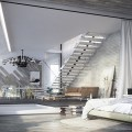 Large white drapes lend a soft visual touch to the industrial bedroom