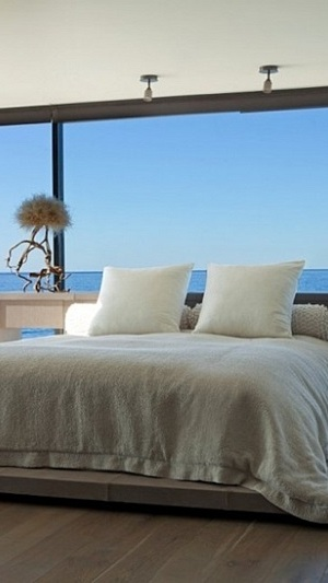 modern bedroom with ocean view 20 Dashing Dining Rooms With A Scenic Ocean View